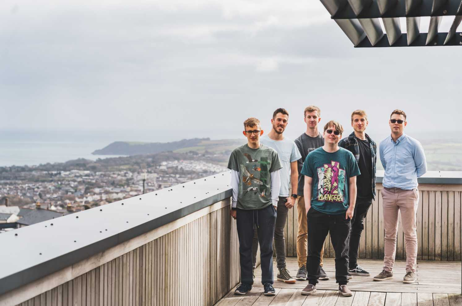 Picture of the hiyield team on a balcony - hiyield are a Digital Agency in Cornwall.